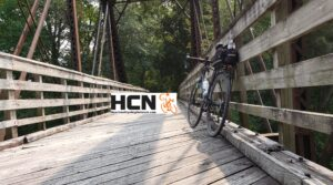 Gravel Bike leaning up against a wooden bridge along the Wabash Trace.